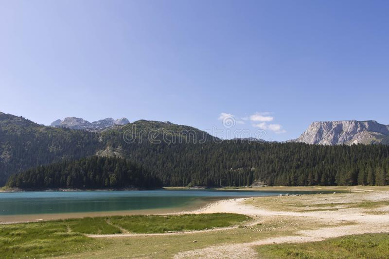 Black lake in Montenegro. Beautiful lake on the background of forest and mountains.  stock photography