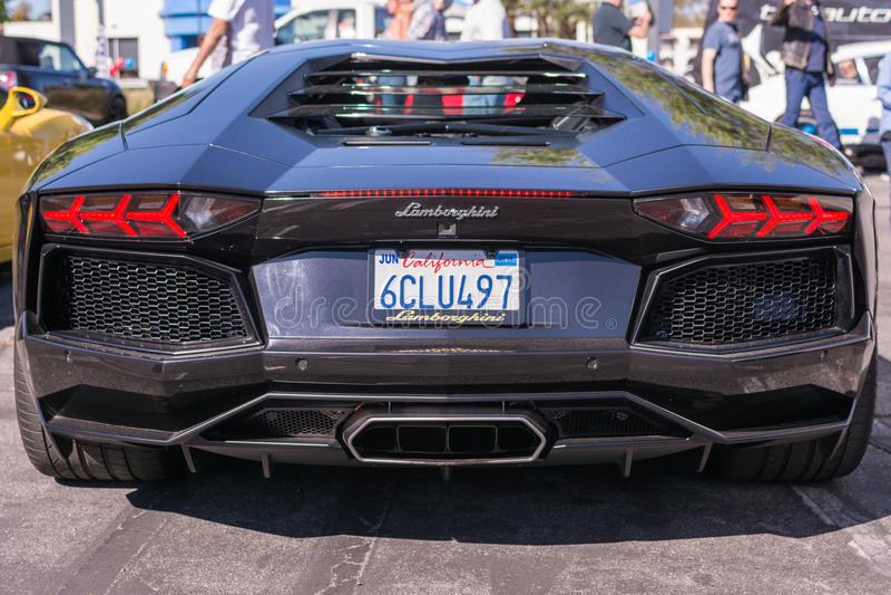 Black Lamborghini on exhibition parking at an annual event Super stock photo