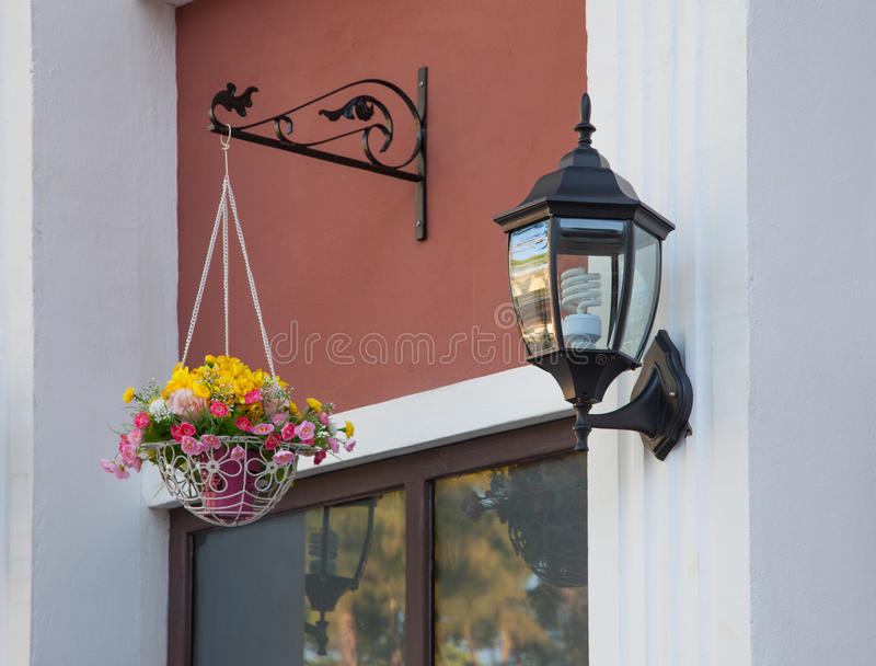 Black Lantern on building wall. Black Lantern mounted on a building wall royalty free stock images