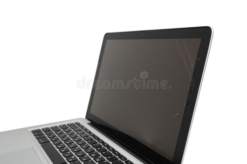 Black laptop with broken screen isolated on white background. Computer, technology, monitor, service, communication, equipment, modern, work, accident, display royalty free stock photography