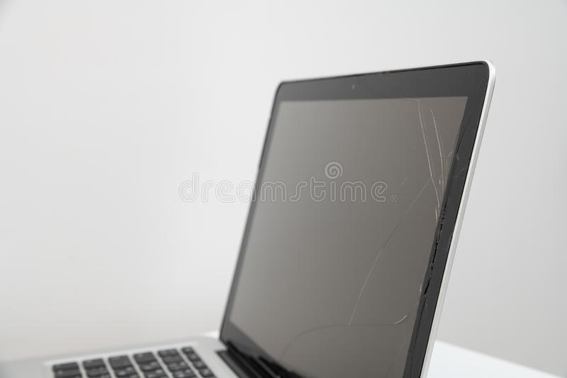 Black laptop with broken screen isolated on white background. Computer, technology, monitor, service, communication, equipment, modern, work, accident, display stock photos