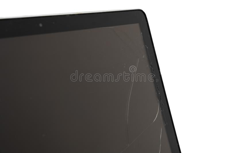 Black laptop with broken screen isolated on white background. Computer, technology, monitor, service, communication, equipment, modern, work, accident, display royalty free stock images