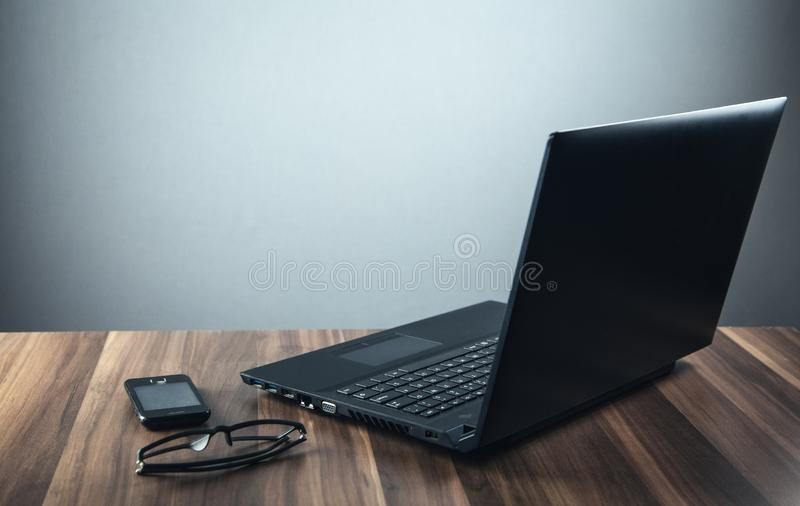 Black laptop in the desk. Business concept royalty free stock photos