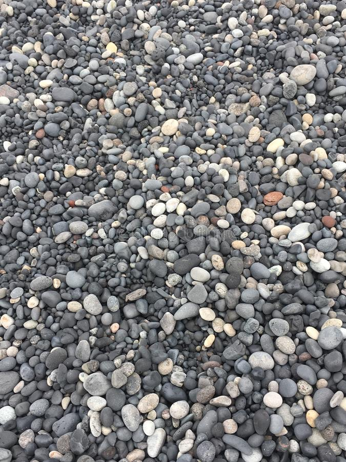 Black Lava Beach pebbles royalty free stock image