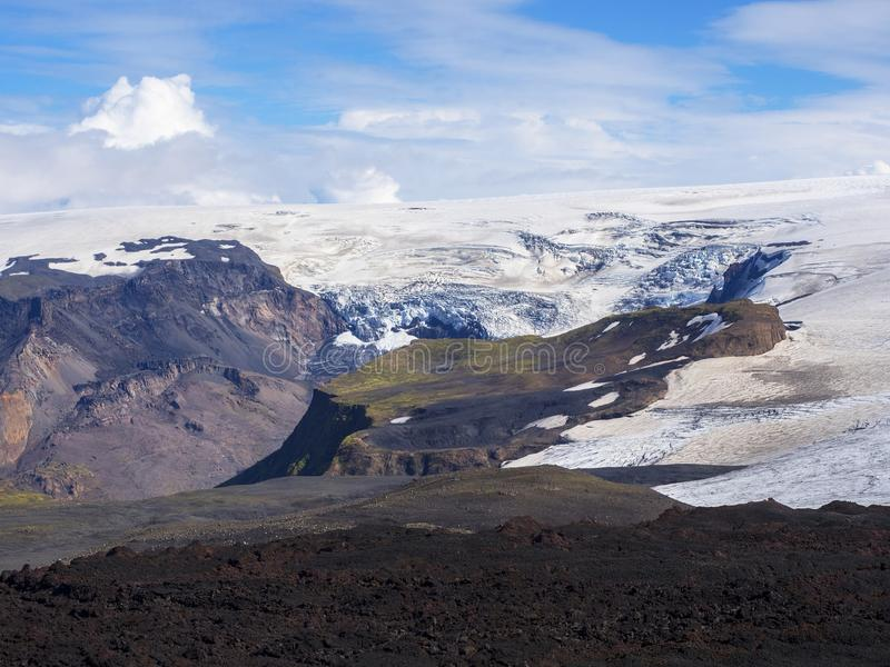 Black lava fields of the Eyjafjallajokull volcano and glacier. Iceland royalty free stock photo