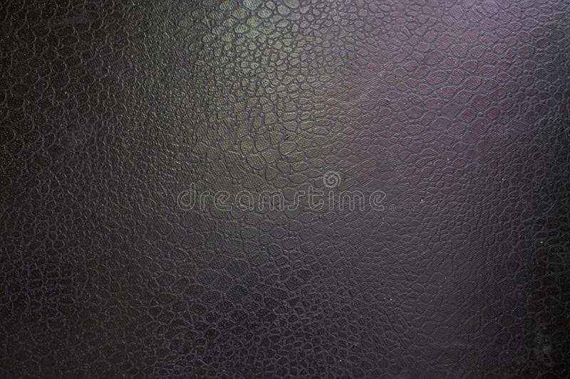 Black leather background with pink and green highlight royalty free stock photos