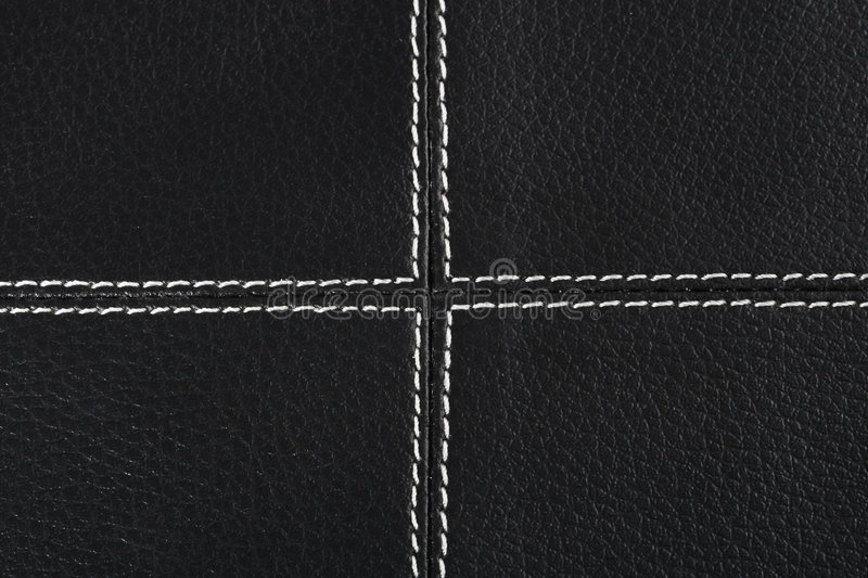 Black leather background stitched up by white stock images