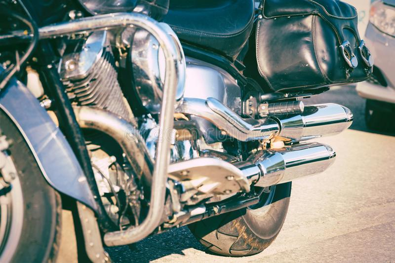 Black leather bag on a black powerful motorcycle. Soft focus. Selective focus royalty free stock photos