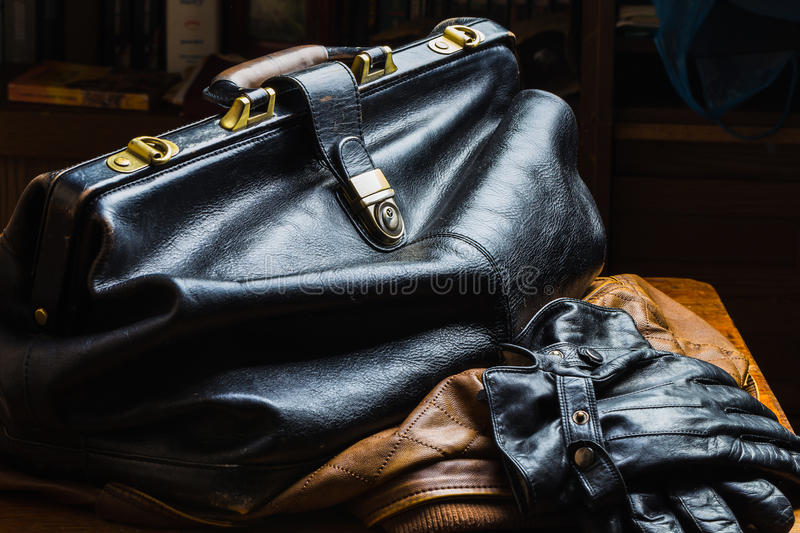 Black leather bag. On a dark background royalty free stock photos