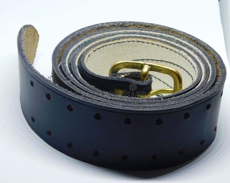 Black leather belt. Black male belt on white background isolated royalty free stock photo