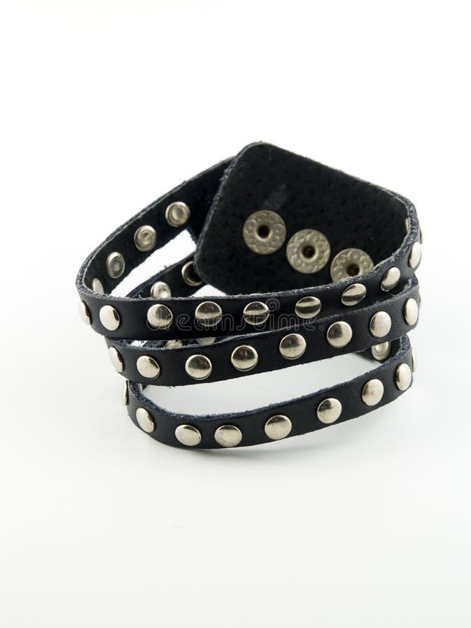 Black Leather Bracelet. Black leather punk style bracelet with silver studs royalty free stock photography