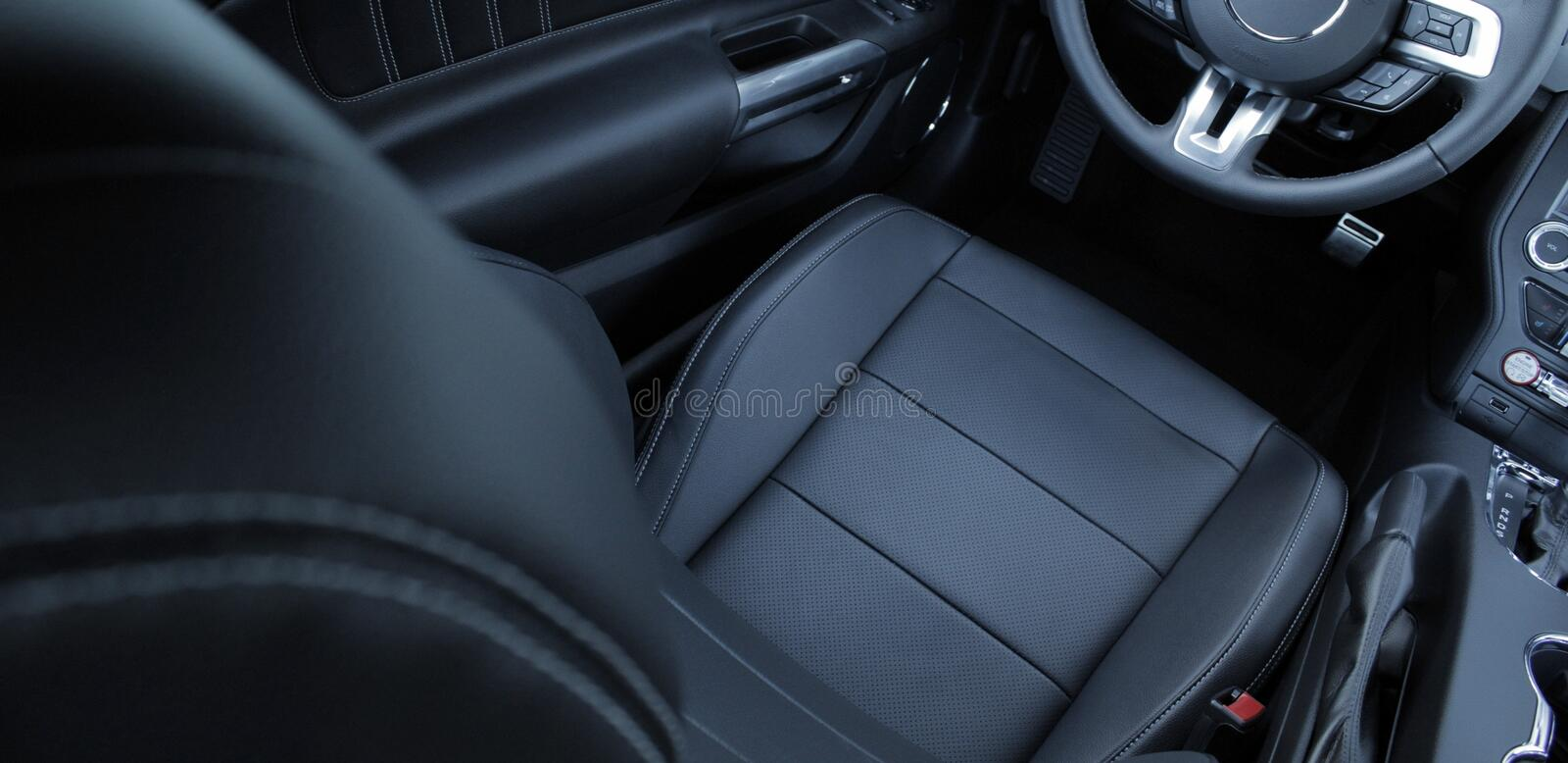 black leather and chrome parts in car interior stock image image 70098609. Black Bedroom Furniture Sets. Home Design Ideas
