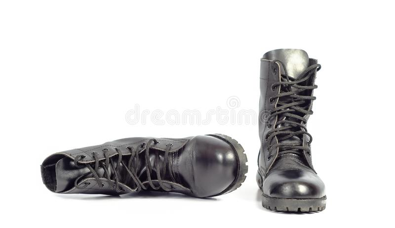 Black Leather combat boot or Army Boots. On white royalty free stock photos