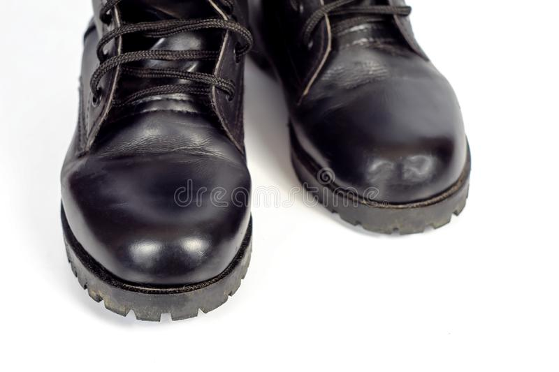 Black Leather combat boot or Army Boots. On white royalty free stock photo
