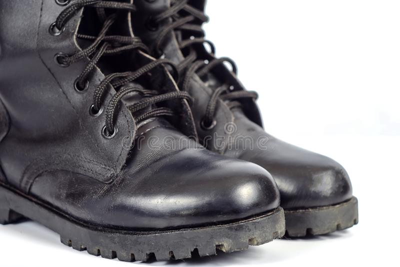 Black Leather combat boot or Army Boots. On white stock photo
