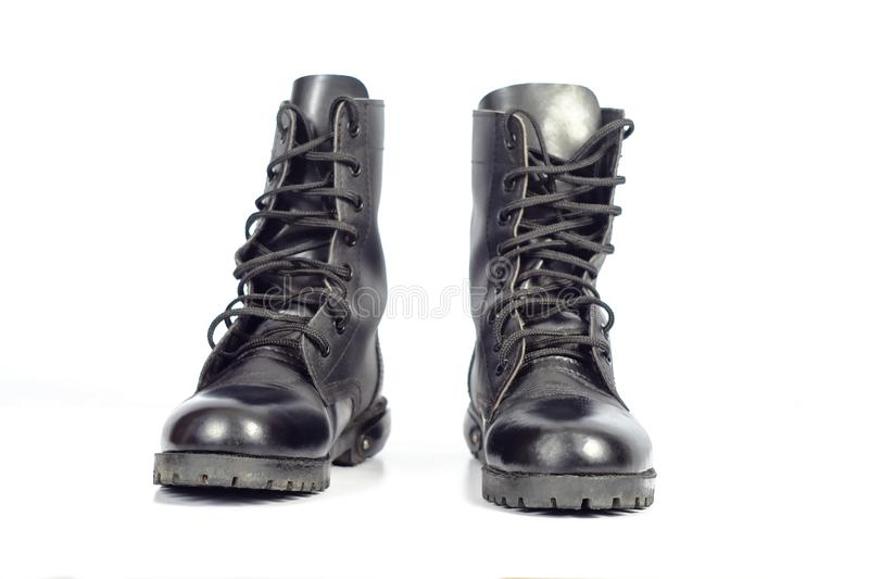 Black Leather combat boot or Army Boots. On white royalty free stock images
