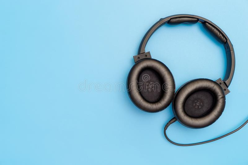 Black Leather Headphone on blue for Music Concept. Black Leather Headphone on blue copy space for Music Concept royalty free stock image
