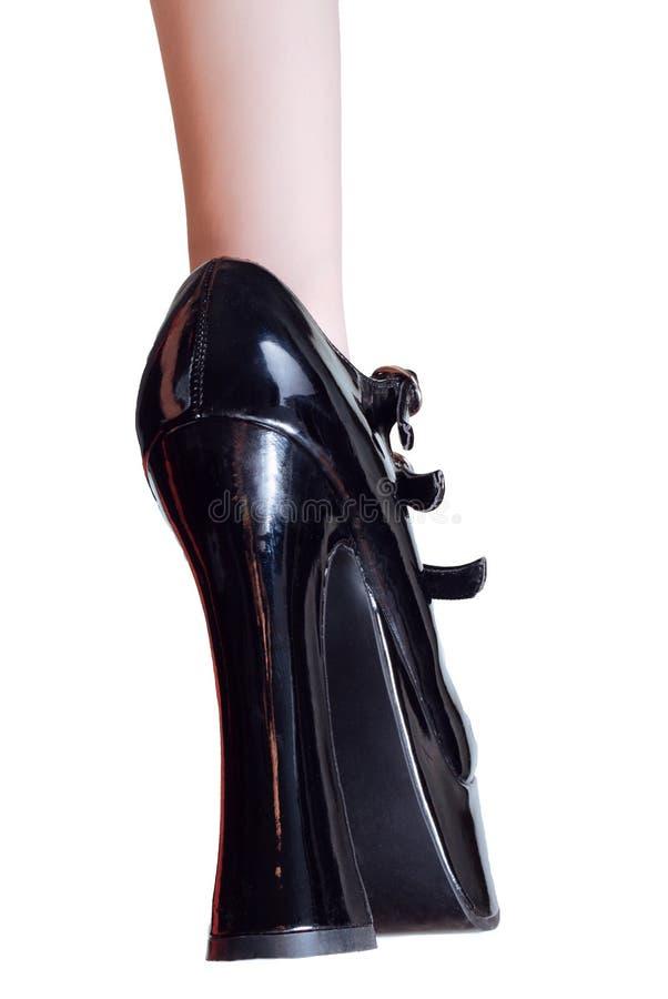 Black leather high-heel shoe royalty free stock photo