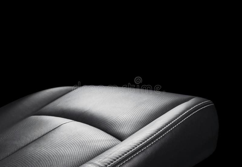 Black leather interior of the luxury modern car. Perforated Leather comfortable seats isolated on black background. Modern car int. Erior details. Car detailing royalty free stock images