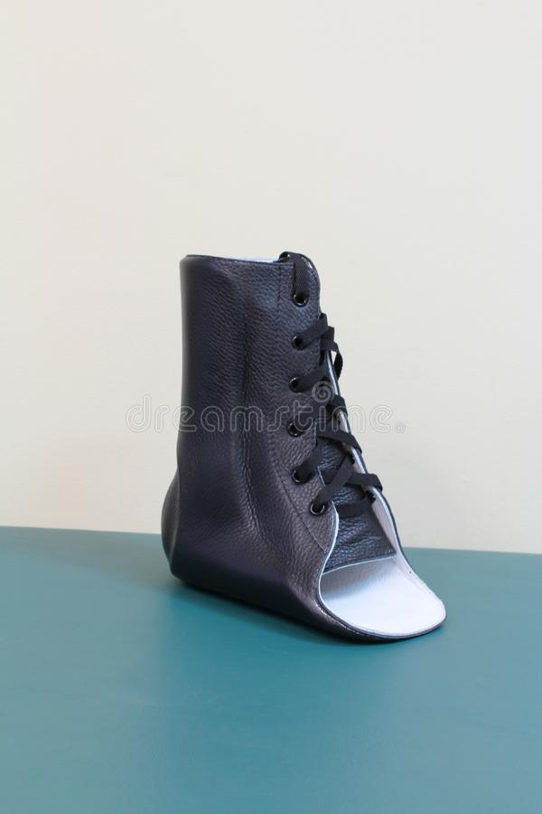Black leather lace up ankle brace quarter turn stock photography
