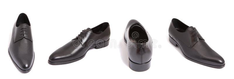 Black leather men shoe. Isolated on white stock photos
