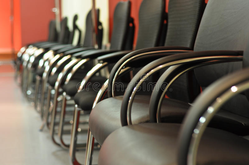 Black leather office chairs. Close-up royalty free stock photography