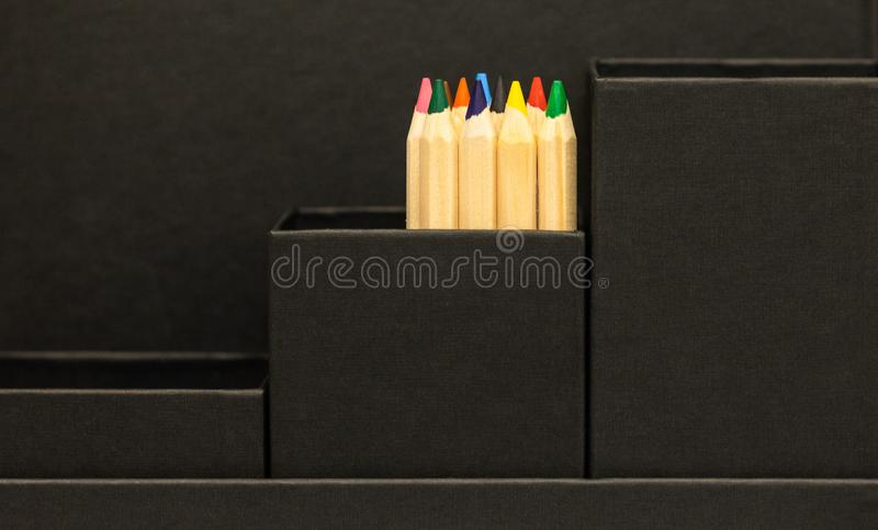 Black leather office holder with colored pencils royalty free stock photography