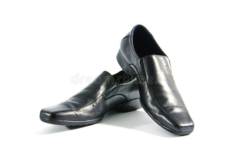 Black leather shoes. On white background stock image