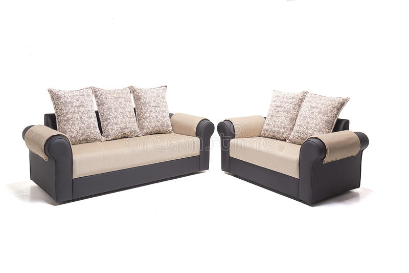 BLACK LEATHER SOFA SET WITH GOLDEN COVERS and cushions over it WITH WHITE BACKGROUND. stock photo