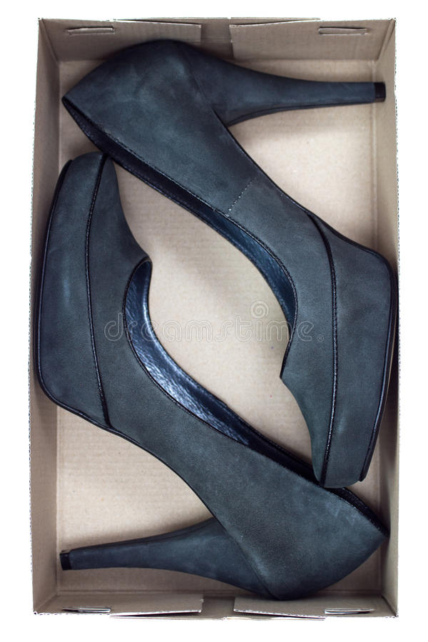 Black leather stiletto heels. In the box royalty free stock photography