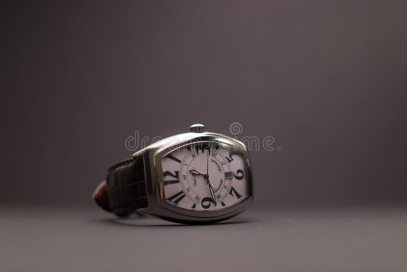 Black Leather Strap Silver Rectangular Analog Watch royalty free stock photo