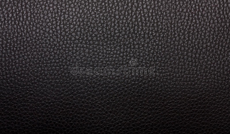 Black leather texture. The artificial black leather texture stock photo