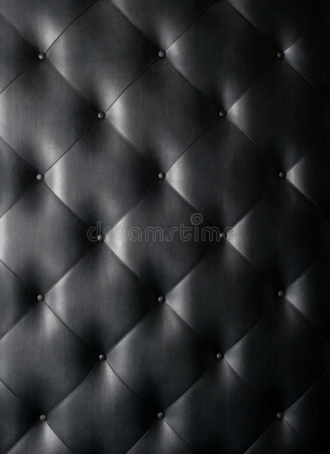 Black leather texture background. Black leather button-tufted texture background royalty free stock photo