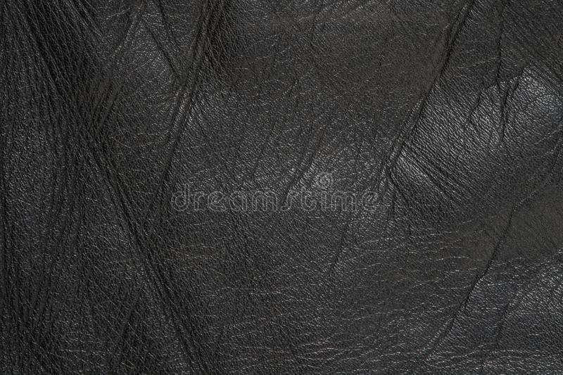 Black leather texture. Background close up stock photography