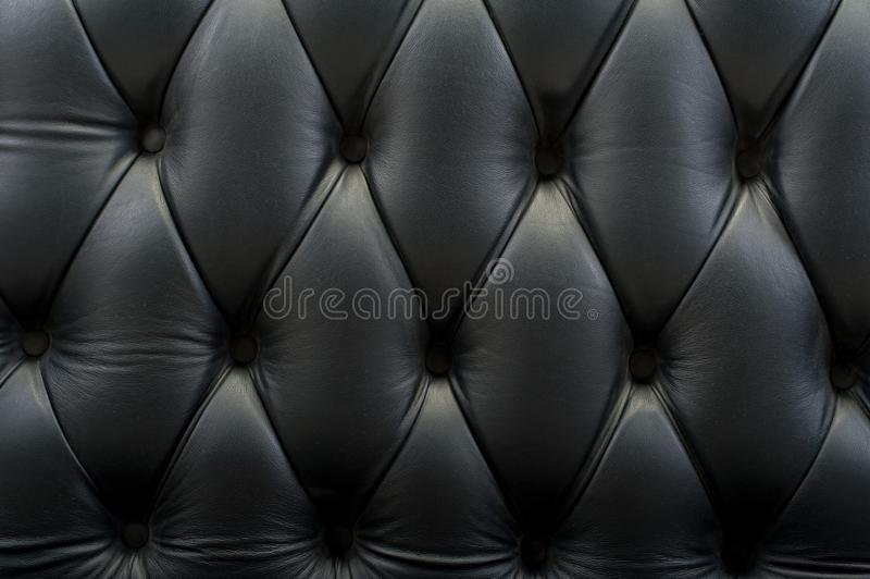 Black leather texture background wallpaper. Selective focus royalty free stock photography