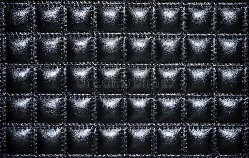 Black leather upholstery of furniture stock photography