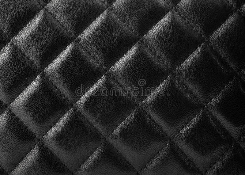 Black leather upholstery. Texture with great detail for background royalty free stock photos