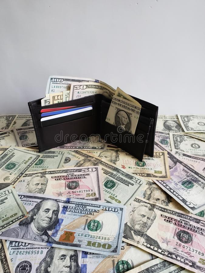 black leather wallet with american dollars bills stock images