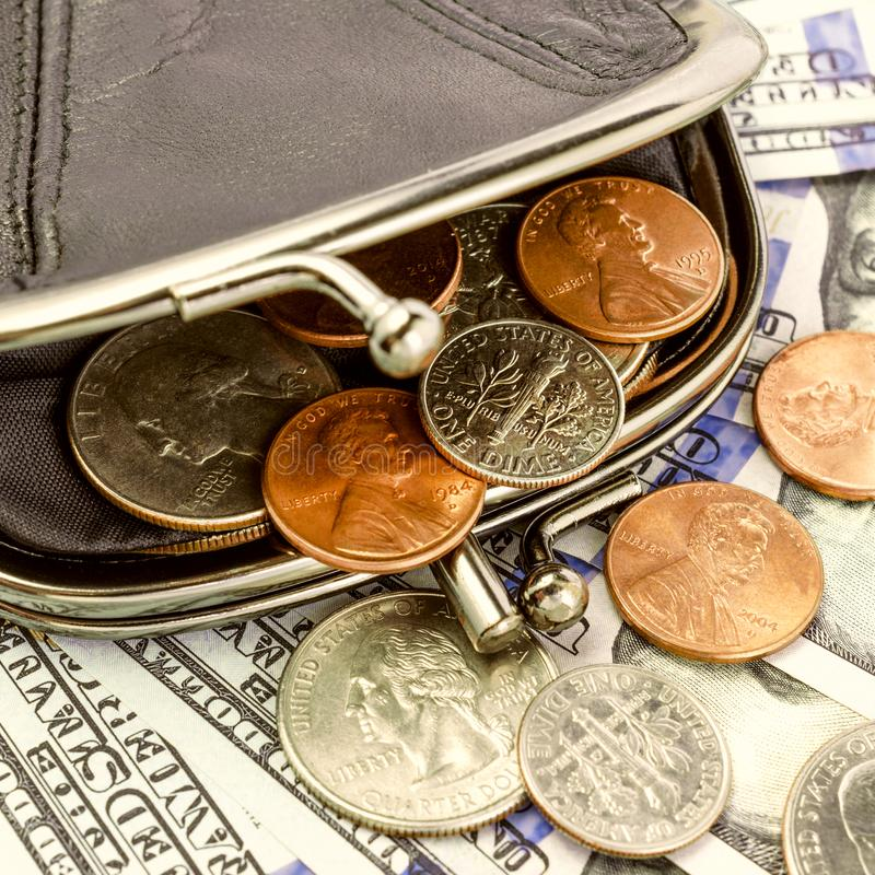 Black leather wallet with banknotes and coins US. Open. Finance stock image