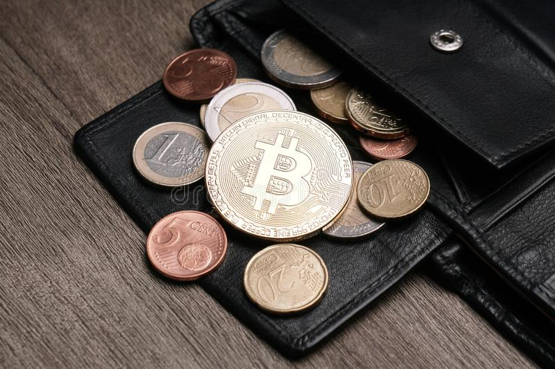 Wallet with bitcoin euro and cent coins royalty free stock photos