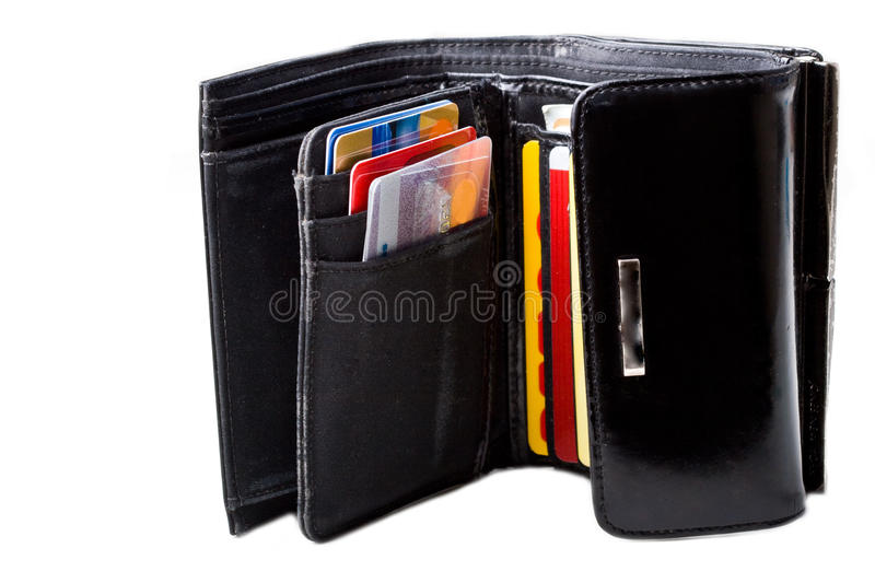Black leather wallet with credit cards isolated. Black leather wallet opened filled with credit cards close up isolated stock photo