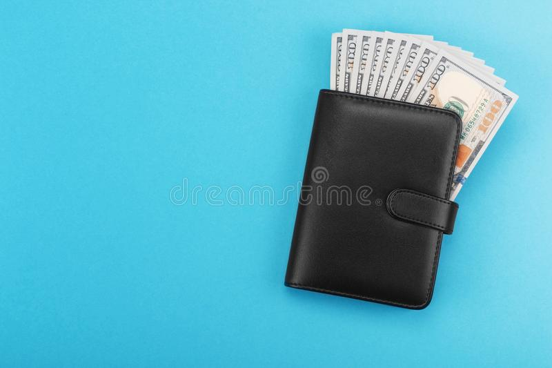 Black leather wallet with dollars cash royalty free stock image