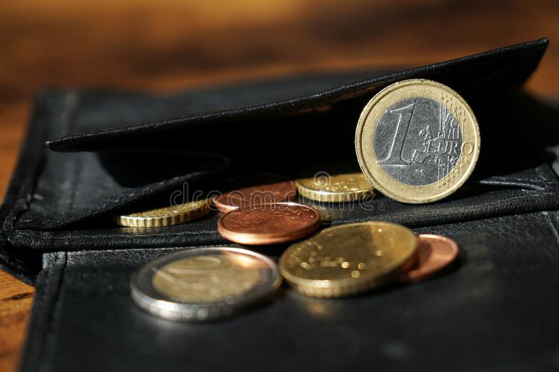 Wallet with euro and cent coins royalty free stock image