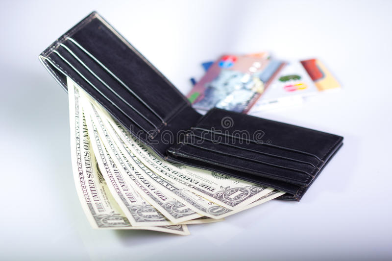 Black leather wallet with one dollar banknotes stock photo