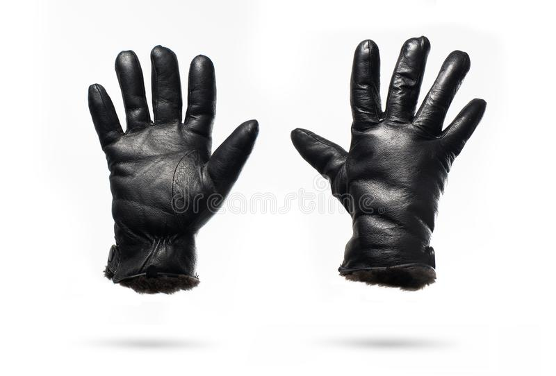 Black leather winter gloves isolated on white background royalty free stock photos