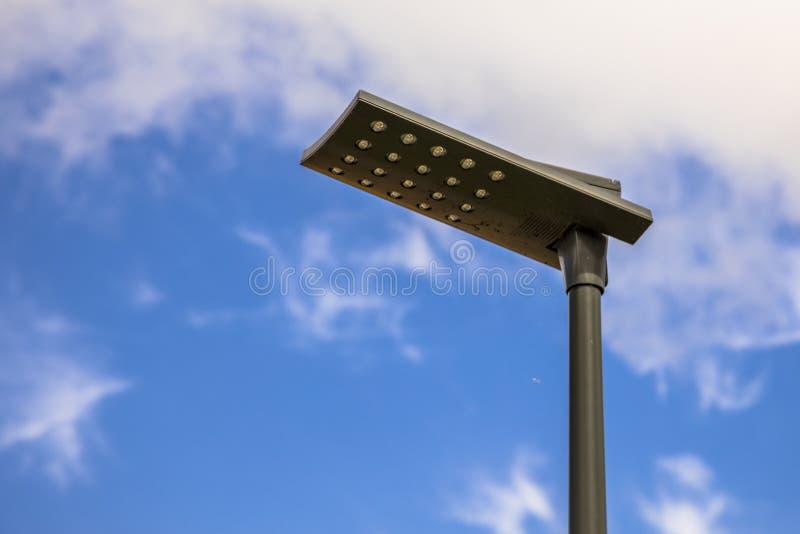 Black LED street light. LED street light with black pole and armature aigainst blue summer sky stock photo