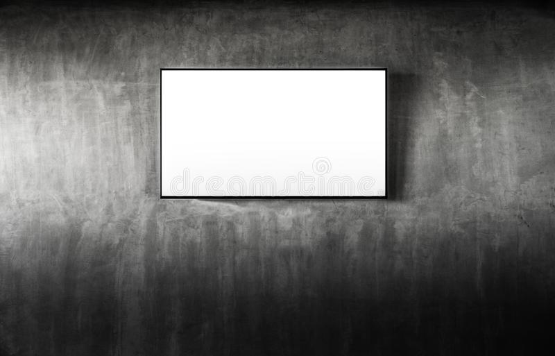 Black LED tv television mockup blank on gray concrete background. Living room led tv on concrete wall. Smart Tv mockup with blank. Screen hanging on the wall in royalty free stock photography