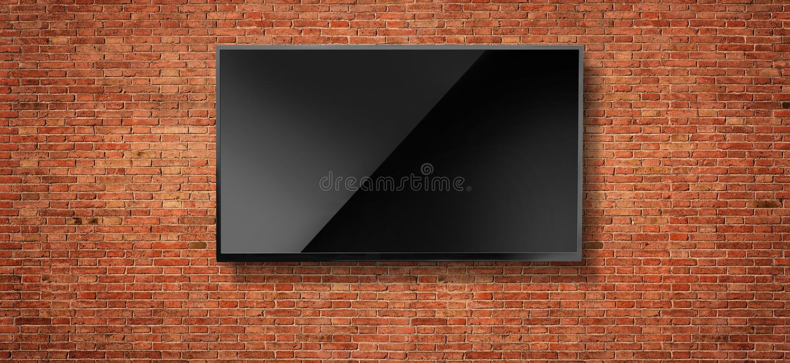 Black LED tv television. Screen blank on red wall background royalty free stock photos