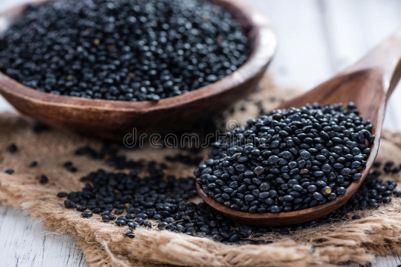 Black Lentils. Portion of Black Lentils (detailed close-up shot royalty free stock photo