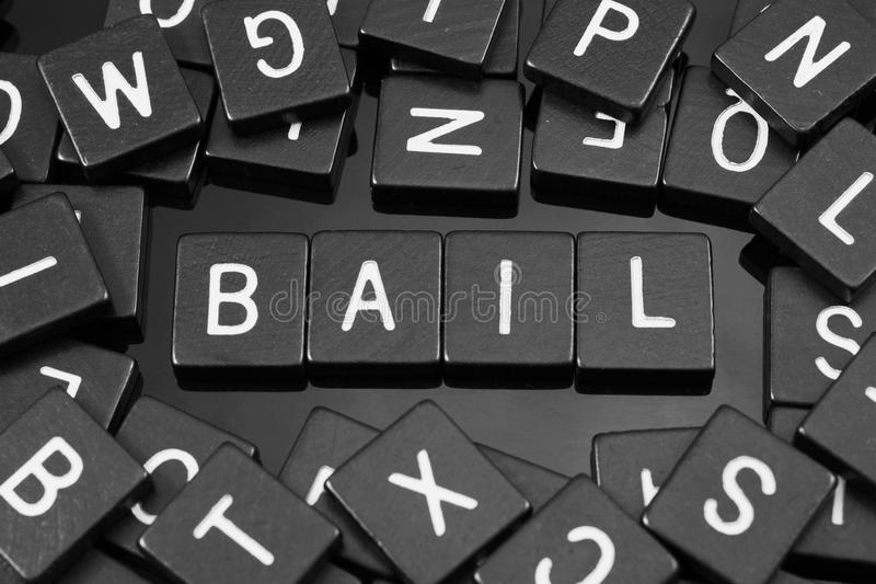 Black letter tiles spelling the word & x22;bail& x22; stock image